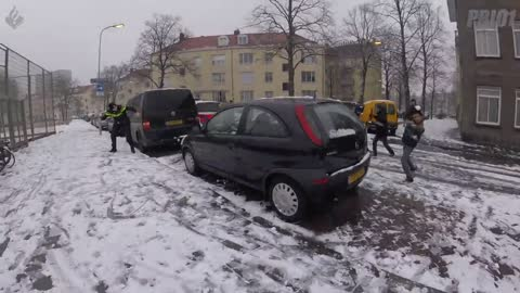 Police offices participates in playful snowball fight
