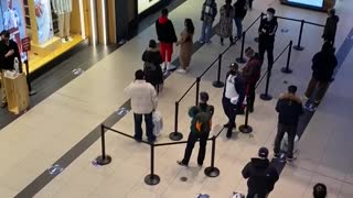 Nike store line at Toronto's Eaton Centre on reopening day