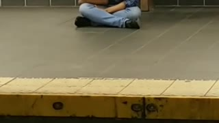 Blue flannel subway station sitting face down - Video