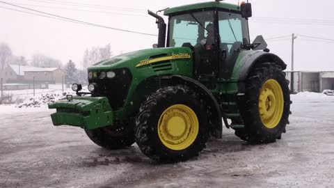 Driver Shows Drifting Skills With A John Deere Tractor