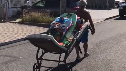 Man uses mattress to move boogie boards