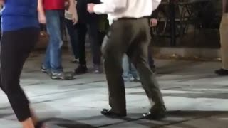 Music older guy dancing outside with people  - Video