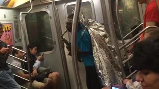 Guy blue shirt foil wings playing saxophone subway train man - Video