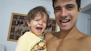 Father and Son Bond Over Laughter - Video