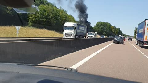 a burnt car on the highway