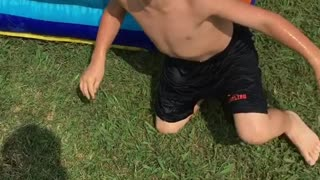 Collab copyright protection - front flip little boy water slide