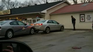 Driver Rams into Police Car at Gas Station - Video