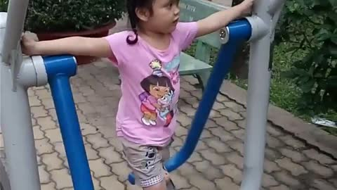 4-year-old cute baby exercise in the park