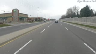Motorcycle Rider Cleans up the Road While Riding