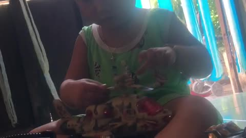 little boy sitting and playing with toys