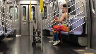 Man with orange pants with loud music on