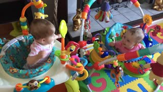 Twin babies communicate in adorable fashion