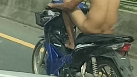 Undressed Man on a Motorcycle