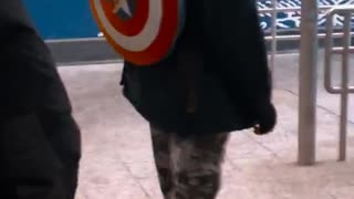 Guy with captain america shield backpack  - Video