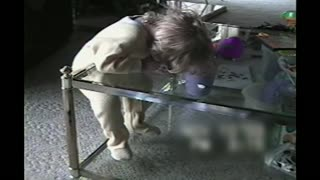 Toddler Falls Asleep Standing Up On A Glass Table - Video