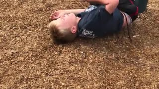 Kid in black shirt tries to do flip and falls