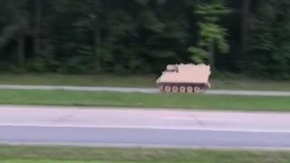 Police Chase Tank down Highway
