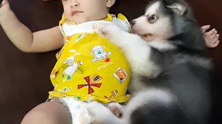 Baby and Puppy Relax Together