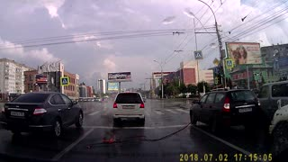 Electricity Cable Falls on Car - Video