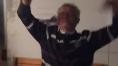 Old man dancing to party music