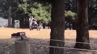 Dirt bike gets ahead of bald man in forest