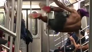 Shirt guy black shorts purple bandana dancing on pole subway - Video