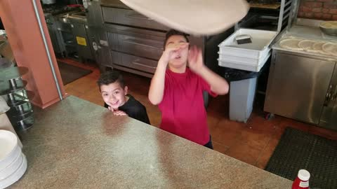 Pint Sized Pizza Tossing Brothers