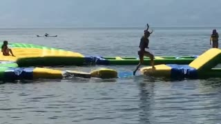 Collab copyright protection - girl water obstacle course yellow