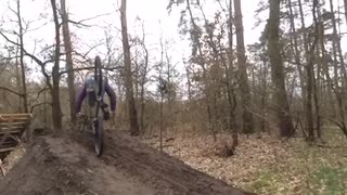 Slowmo guy attempts 360 bicycle spin off wooden ramp, faceplants - Video