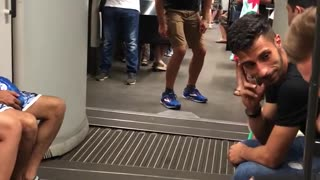 Guy pretending to ride middle of subway train