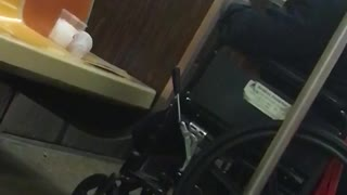 Man in wheelchair smokes cigarette inside subway  - Video