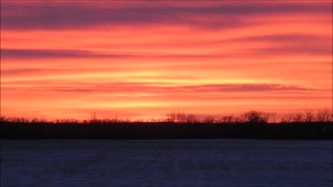 Vibrant Colors Of Exhaust Clouds Spread Across the Prairie Sunset