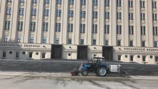 Washing tractor near Ministry of Defense Russia