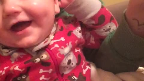Laughing baby thinks quacking sounds are hysterical