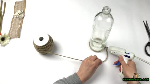 How to Upcycle an Empty Bottle Into a Gorgeous Homespun Vase - DIYnCrafts.com