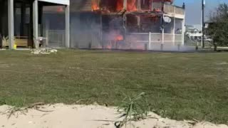 Close up of house on fire