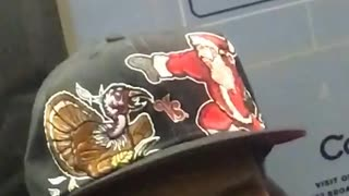 Man with turkey and santa on black hat