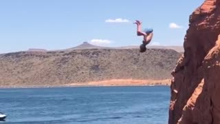 Back flip off clip slaps back on water