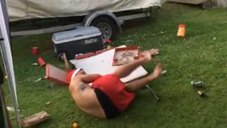 Shirtless santa hat slides across white table into another white table - Video