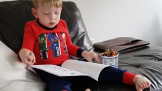 Wee man coloring on a Sunday