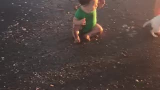 Babies first steps at beach