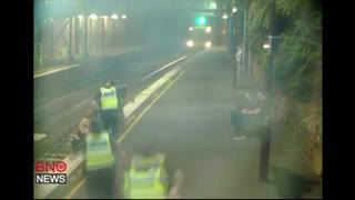 CCTV footage captures moment Australian police save woman trapped on train track - Video