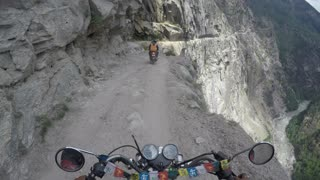 Daredevils take on deadliest road in the world - Video
