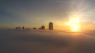 Drone captures Dallas skyline above fog bank
