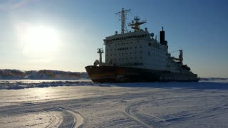 Russian Tanker Breaking Through Icy Waters - Video