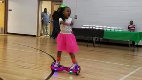Little girl shows off hoverboard dance moves