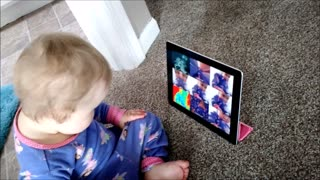 Baby curiously plays with Apple Photo Booth - Video