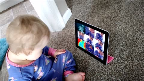Baby curiously plays with Apple Photo Booth