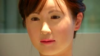 Humanoid robot starts work at Japanese department store - Video