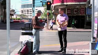 Magician rips homeless man's sign, then surprises him! - Video